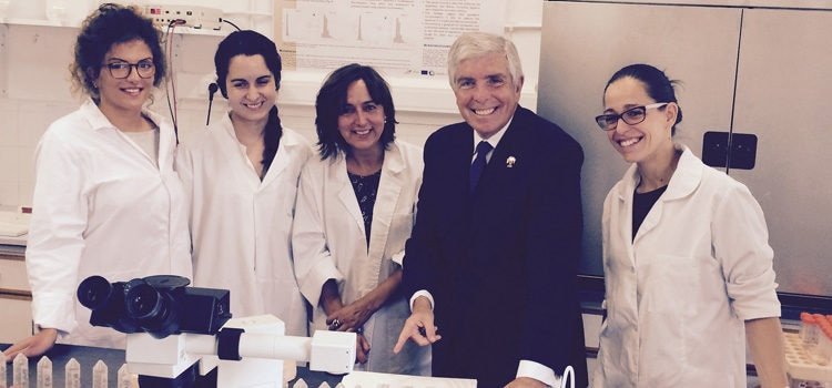 The Ambassador with four female researchers