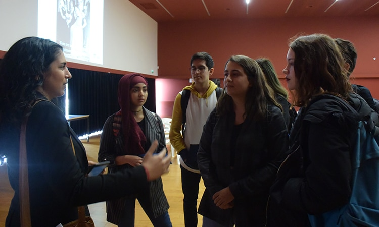 Roshni Nirody talking with students after the presentation.
